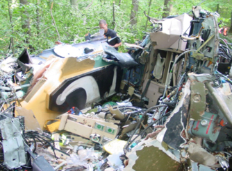 Wreckage, shown aft of the cockpit. Note that the roof of the helicopter has been completely torn off. Photo: MSP