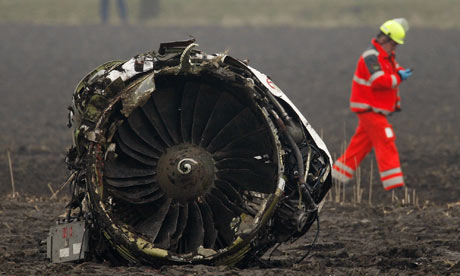 Engines, under full power, broke free as the airplane hit the boggy ground.