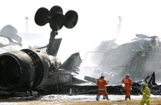 Wreckage of FedEx MD-11 at Tokyo's Narita Airport. The airplane flipped upside down, the third such landing accident in 12 years. There have been other landing accidents where the airplane remained upright, but the overall safety record of the MD-11 is checkered.