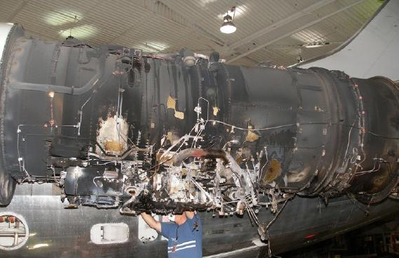 Cowling removed, showing blackening and extent of damage.