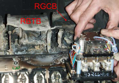 Comparison of the Right Generator Circuit Breaker (RGCB) and the Right Bus Tie Breaker (RBTB) contacts with a new contactor held in position. The damage to the Ground Series Relay (GSR), located directly below the RBTB, appeared to have been caused by molten metal dropping down from the contactors above.
