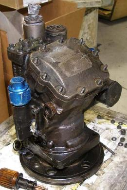 The fire-damaged left hydraulic pump. The case was fractured, and when investigators pumped 20 psi hydraulic fluid into the pump, the fluid escaped through the fractures.