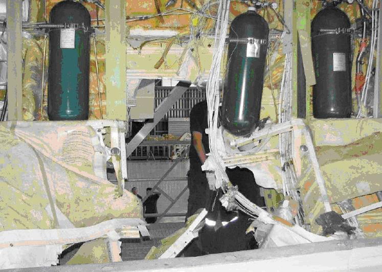 The missing oxygen cylinder on the Qantas B747, which burst with a BANG, rattled around inside the airplane, then punched a hole in the fuselage and fell 29,000 feet to the Pacific Ocean.