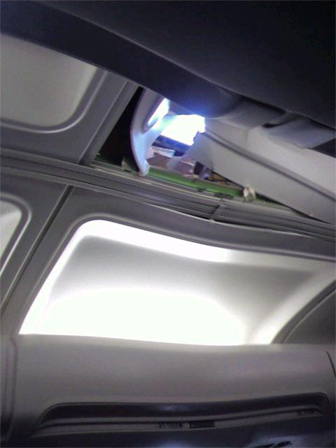 The passengers' view of the hole in the ceiling.