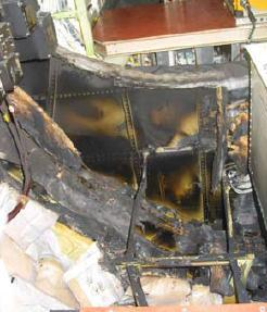 Burnt structure and insulation blankets directly below the P200 power panel.